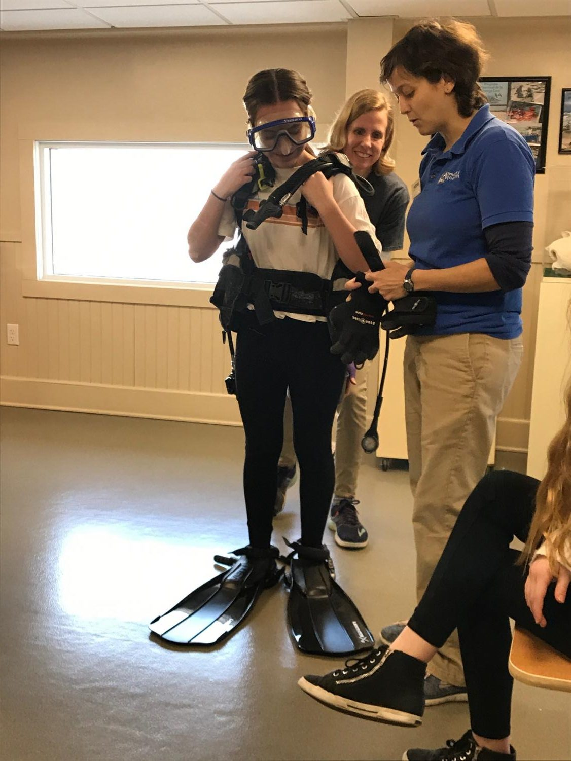 7th Grader Katie Zaranski tries on the scuba gear